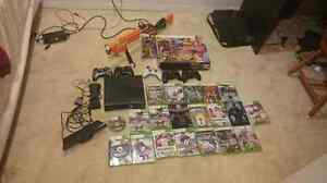 Xbox 360 with kinekt,hunting gun and 5 controllers  + games