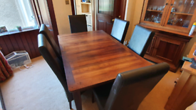 Dining room table with six leather chairs
