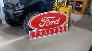 LARGE METAL TRACTOR AND GASOLINE SIGNS