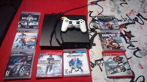 2 consoles de jeux PS3 avec jeux