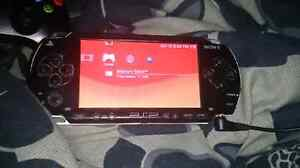 PSP WITH CASE AND CHARGER AND SD CARD.