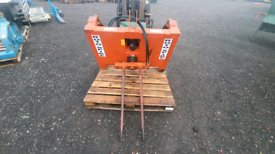 Tractor front loader three point linkage bale spike unroller unwinder