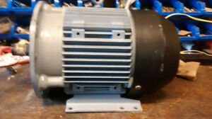 New never installed 3 phase 10hp AC motor.