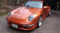 1977 porsche 911 with a 993 super wide turbo body kit