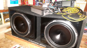 "1000 watt amp with 2 10"" matching subs an box"