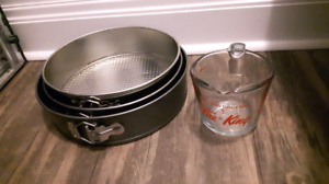 3 round cake pans and a measuring cup