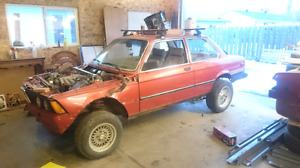 "1982 bmw e21 project with 5"" lift kit"
