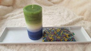 Candle, plate and rocks