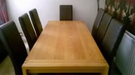 LARGE DINING TABLE AND 8 FAUX LEATHER CHAIRS BY NEXT