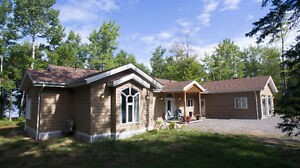 Secluded Waterfront Bungalow with Acreage