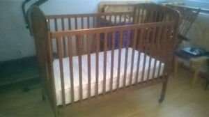 BABY CRIB - SOLID WOOD, IN GREAT CONDITION.