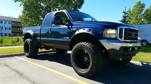 2004 Ford f250 lifted 22x14s on 38s