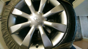 """Set of infiniti factory rims 20"""" with tires in good condition"""