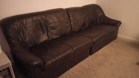 Free four seater black leather sofa