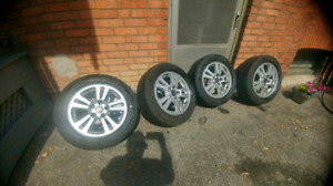 "16 ""Saab Alloy wheels/rims and tires."