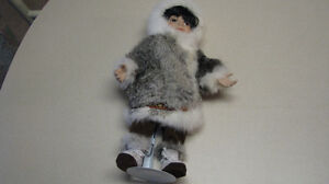 "Beautiful Inuit  doll over 15"" tall on a stand"
