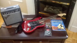GREAT CONDITION CHERRY RED FENDER SQUIER GUITAR + AMP+ EXTRAS