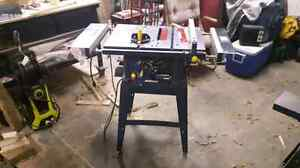 """For sale 10"""" Mastercraft table saw with the stand"""