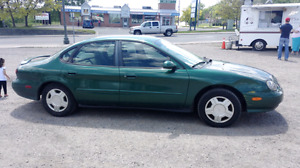 1999 Ford Taurus. Only 160,000+km. Undercoated no rust.