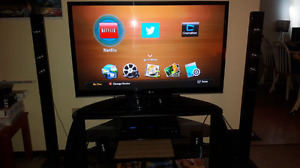 "LG 46"" Flatscreen TV and Samsung Blu-ray home theater system"