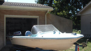 14 ft. comet traveller boat complete with engine and trailer.