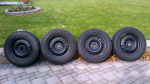 4 Mounted snow tires 235-65-R17