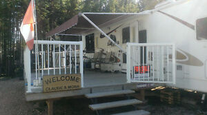 32 foot trailer on leased lot in Candle Lake Golf Resort