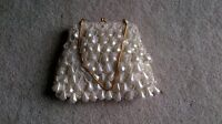 Sparkly pearls with glitter hand bag