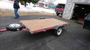 Tilting Flat bed trailer in excellent condition.