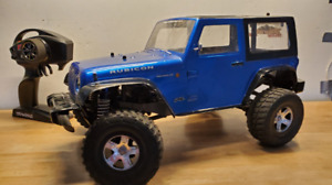 Barely used Traxxas Telluride 4x4 with remote, battery, chargers