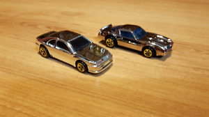 Group 13. Two Chrome Hot Wheels.