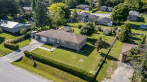 **LISTED**// CHARMING BUNGALOW ON INCREDIBLE SIZED LOT IN ANGUS
