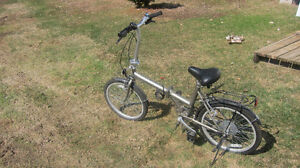 Two  Adventurer 6 speed folding bycycles