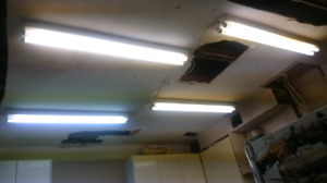 "4 FLUORESCENT LIGHT FIXTURES 48"" LONG WITH TUBES $20"