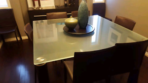 Modern thick glass dining table and chairs