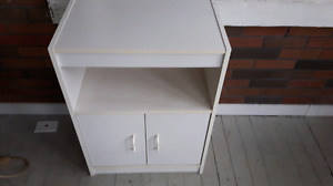 White cupboard and stand.