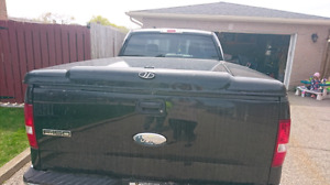 Hard tonneau cover Ford F150 black 250$