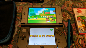 """New"" Nintendo 3DS XL + games + extras"