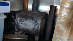 Antique wood stove fireplace heater.
