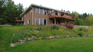 House, shop, and acreage 15 min to Costco , 20 min to Big White