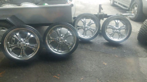 Low profile.           Chrome rims and tires