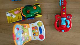 Todlers toy bundle,laptop,guitar,tractors etc.