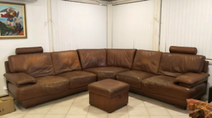 Brown couch and ottoman