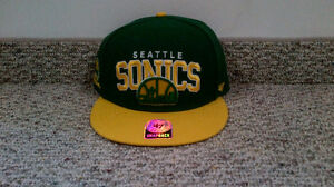 Seattle Supersonics snapback and Jays 7 1/4 fitted hat