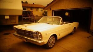 Enjoy summer cruising in a 1966 Ford Galaaxie 500 Convertible