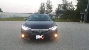 2016 Honda civic touring+winter tires+safety/Negotiable