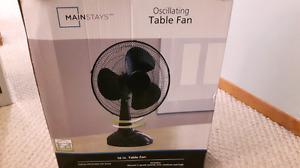 Oscillating table fan. 16 inches and black in colour. Brand new