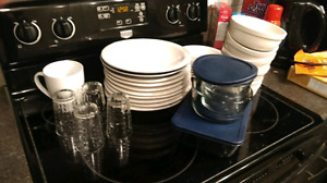 Dishes tubber wear glasses and a couole mugs plues cutlery