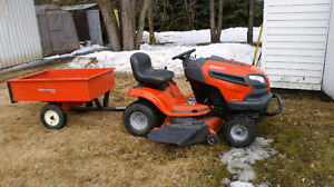 Riding lawnmower  with trailer.
