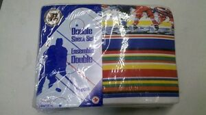 new sheets still in sealed package fit a double bed.